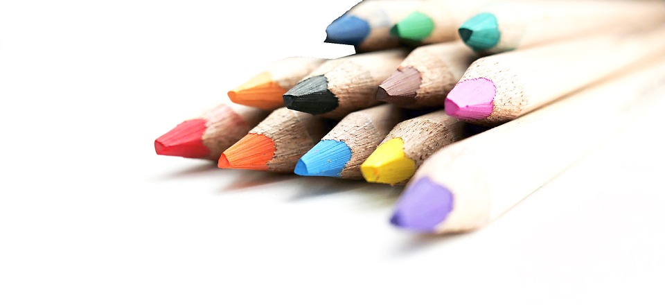 Image of colorful colored pencils, crayons and pens.