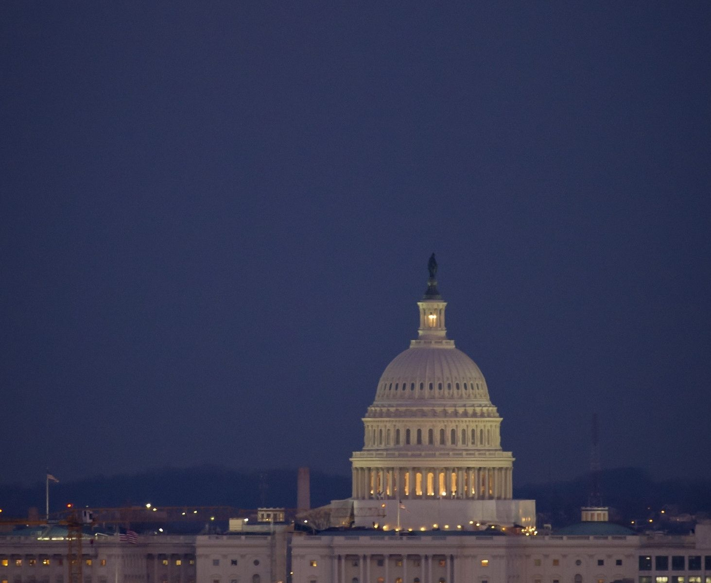 Picture of capital hill with a full moon.