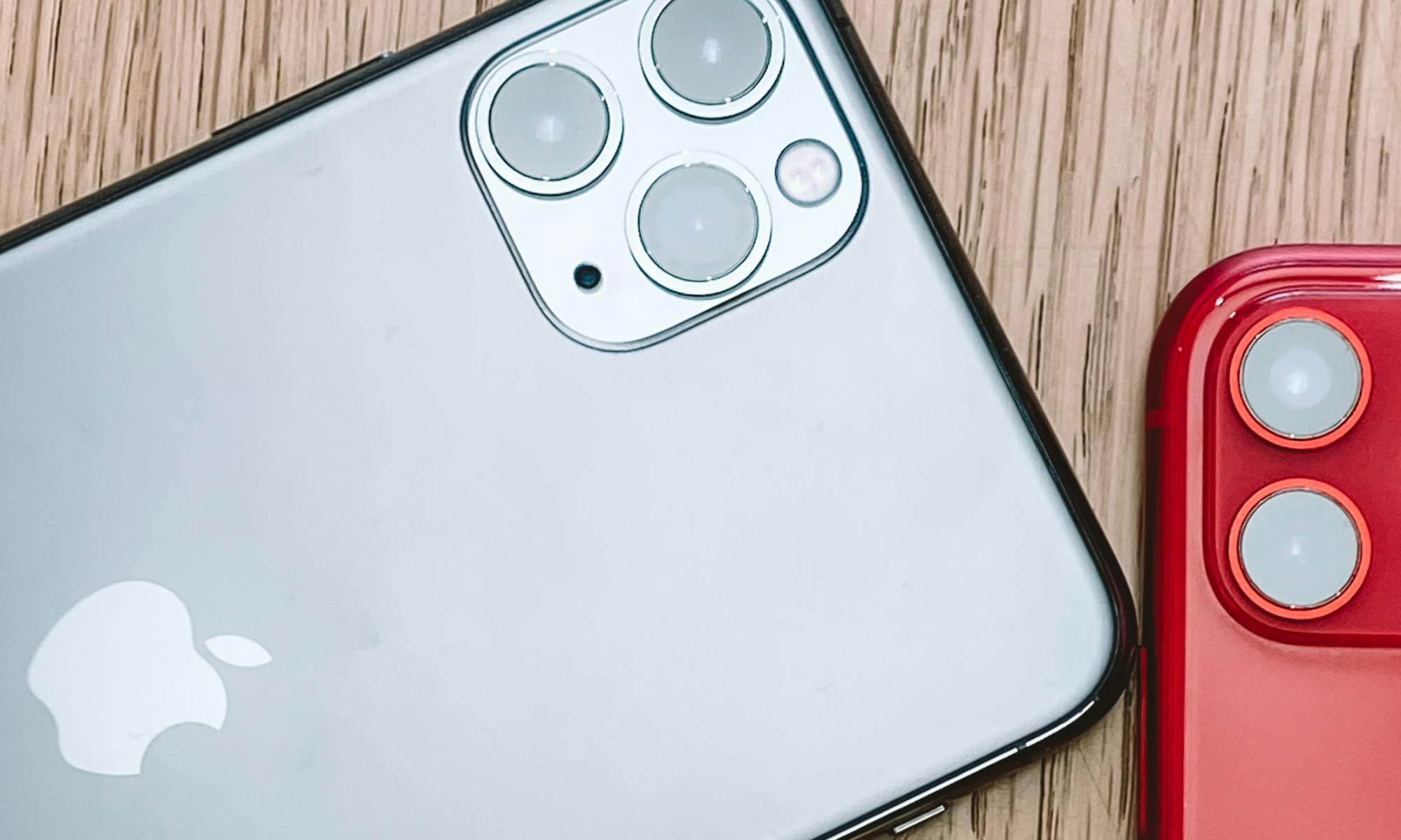 Silver iPhone 11 on a brown surface.